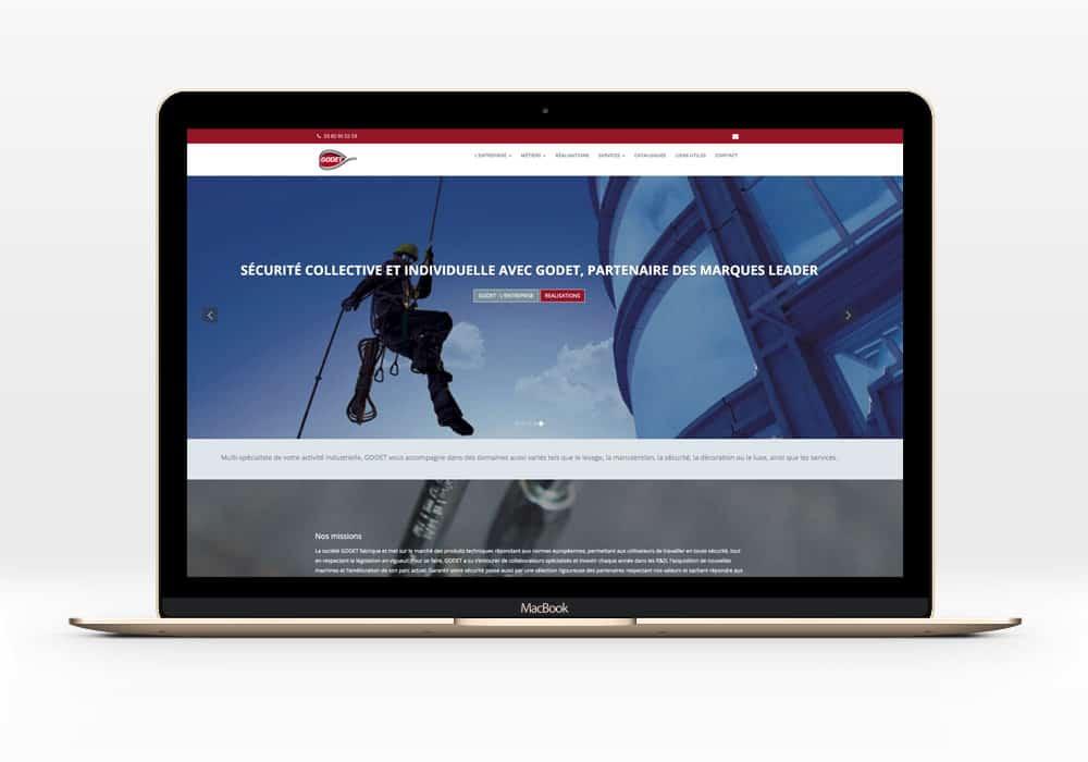 page accueil du site godet.fr sur macbook montrant un laveur de vitres